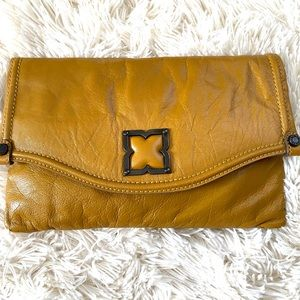 BCBGMAXAZRIA • folding leather clutch bag NWT
